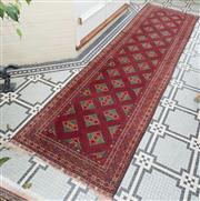 Sale 8575H - Lot 68 - A Persian runner with geometric pattern on red ground 300cm x 84cm