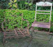 Sale 8568A - Lot 29 - Two iron garden chairs, one with arms, and missing slat