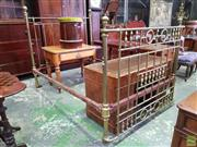 Sale 8617 - Lot 1039 - Late Victorian/ Edwardian Brass Double Bed, the bowed front with spindle gallery & rings