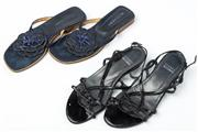 Sale 9027F - Lot 73 - A pair of Stuart Weitzman black strappy low wedge sandals together with a pair of denim Witchery slip ons. Both pairs size 7