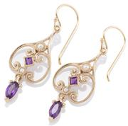 Sale 9066 - Lot 381 - A PAIR OF NOUVEAU STYLE GEMSET EARRINGS; 9ct gold scrolling frames set with carre cut amethysts and seed pearls to navette cut ameth...