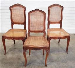 Sale 9188 - Lot 1509 - Pair of oak chairs with rattan seats and another (h:100 x w:48 x d:44cm)