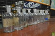 Sale 8260 - Lot 1023 - Set of Ten 500ml Early Glass Pharmacy Bottles with original stoppers