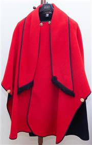 Sale 8562A - Lot 207 - A David Barry reversible black and red cape, with gilt buttons and built in scarf