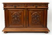 Sale 8980J - Lot 75 - A superior quality French Henri II solid walnut and oak buffet C: 1860. The double edge moulded top above a pair  of carved centra...