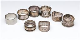 Sale 9098 - Lot 256 - Group of eight hallmarked sterling silver napkin rings