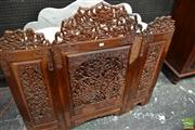 Sale 8460 - Lot 1029 - Kashmiri Walnut Three Panel Firescreen, carved & pierced with lotus flowers & seed pods