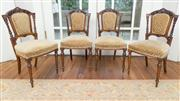 Sale 8470H - Lot 111 - A set of four late C19th French carved walnut chairs, the backs with columns and pierced work upholstered in a cut moquette velvet o...