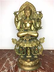 Sale 8995H - Lot 51 - A brass figure of a seated female Hindu deity, total height 60cm