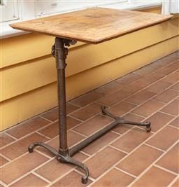 Sale 9120H - Lot 243 - A cast iron and oak adjustable reading table, Height 68cm x Width 61cm x Depth 45cm
