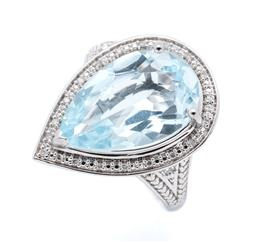 Sale 9253J - Lot 447 - A SILVER TOPAZ AND DIAMOND COCKTAIL RING; drop shape top centring a pear cut blue topaz of approx. 8ct to surround set with 20 singl...