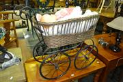 Sale 8093 - Lot 1302 - Dolls Pram with Doll