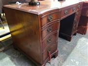 Sale 8774 - Lot 1095 - Georgian Style Burr Walnut Desk, the concave sides each fitted with four drawers, having a drawer & two recessed doors in the centre...