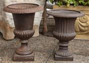 Sale 8902H - Lot 5 - Two cast iron campagna urns on square bases, the larger Height 40cm, diameter 30cm