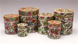 Sale 9122 - Lot 167 - Early Famille Rose Set Of Six Lidded Cylindrical Containers (Tallest 11cm) (some losses and repairs)