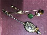 Sale 8774A - Lot 337 - Four dress pins, faux pearl, tigers eye and greenstone