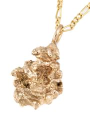 Sale 8915 - Lot 346 - A GOLD NUGGET PENDANT; 10ct gold figaro chain, 1.69g, nugget tests approx. 14ct, wt. 7.78g, length 40cm.