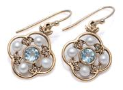 Sale 8999 - Lot 372 - A PAIR OF EDWARDIAN STYLE TOPAZ AND PEARL EARRINGS; quatrefoil mounts each centring a round cut blue topaz surrounded by 3.5mm round...