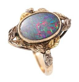 Sale 9182 - Lot 386 - A VINTAGE 9CT GOLD OPAL RING; collet set with an oval opal triplet with good colour range to two tone foliage surround, top 17 x 12m...