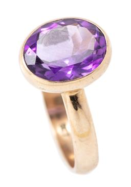 Sale 9182 - Lot 345 - A 9CT GOLD AMETHYST RING; rub set with an oval cut amethyst of approx. 3.06ct, top 12.5 x 10mm, size P1/2,wt. 4.01g.