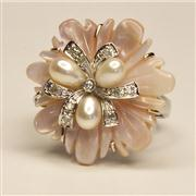 Sale 8036A - Lot 318 - A 14CT WHITE GOLD FLOWER RING; featuring a mother of pearl floral bloom set with freshwater cultured pearls, round brilliant and sin...