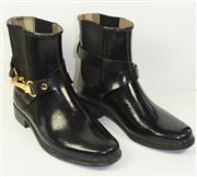 Sale 8460F - Lot 11 - A pair of Burberry black rubber ankle biker boots with classic Burberry check interior and gilt hardware, light wear, size 37