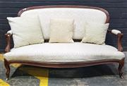 Sale 9014 - Lot 1070 - Late 19th Century French Carved Rosewood Settee, upholstered in a cream scroll fabric & cabriole legs TOGETHER with some loose cushions