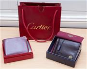 Sale 8562A - Lot 194 - A classic Cartier leather maroon wallet, in original box, with original bag, together with a Wittchen leather wallet in box
