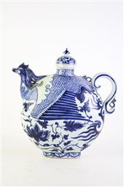 Sale 8835 - Lot 260 - Chinese blue and white Yuan style moon shaped covered tea pot H:31cm