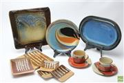 Sale 8644 - Lot 26 - Glazed Ceramics Including Platters And Cups And Saucers (12 pieces)