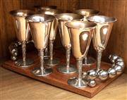 Sale 8942H - Lot 98 - A group of eight silver-plate goblets on a timber tray with a beaded handle