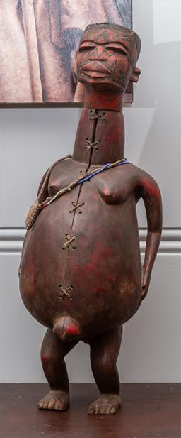 Sale 9160H - Lot 73 - A Makonde carved dancing fetich figure, Mozambique, with red pigmentation, and removable head, with a leather bag and beads, Height...