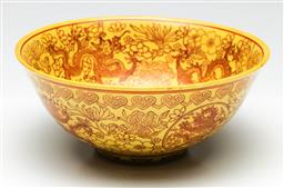 Sale 9209V - Lot 31 - A yellow Chinese glazed bowl, featuring dragons (Dia 19cm)