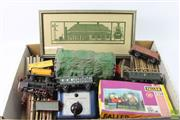 Sale 8635 - Lot 53 - 1950s Three Rail Marklin Trains Set With Track Transformer and carriages