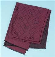 Sale 9027F - Lot 76 - A Gucci monogrammed lambswool and silk scarf in aubergine.160 x 65cm. (pinprick hole)