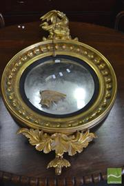 Sale 8335 - Lot 1090 - George III Style Gilt Convex Mirror, surmounted by an eagle with cannon ball shot & foliage below