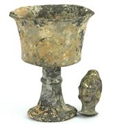 Sale 8390A - Lot 4 - Archaic Metal Footed Vessel with a Small Ceramic Buddha Head