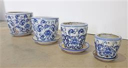 Sale 9134 - Lot 1526 - Four matching blue and white planters with saucers