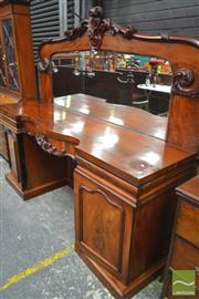 Sale 8282 - Lot 1040 - Victorian Carved Mahogany Breakfront Sideboard, the carved back with later mirror, above three drawers, two doors and fill-in back p...