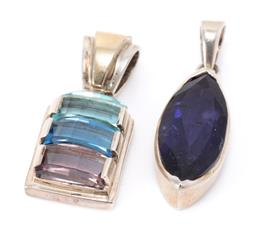 Sale 9182 - Lot 329 - TWO SILVER GEM SET PENDANTS; one collet set with a navette cut iolite, size 34 x 11mm, other rectangular shape featuring rectangular...