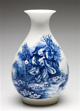 Sale 9238 - Lot 96 - A Chinese blue and white ceramic pear shaped vase featuring man carrying harvest (H:31.5cm)