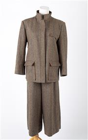 Sale 8550F - Lot 250 - A vintage rare Gucci lined wool mix tweed suit; jacket and three quarter length pants, size 46 (pants a size 8, jacket approx a 10).