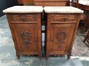 Sale 8868 - Lot 1001 - Pair of French Carved Oak Bedside Cabinets, with coloured marble tops, a drawer & panel door