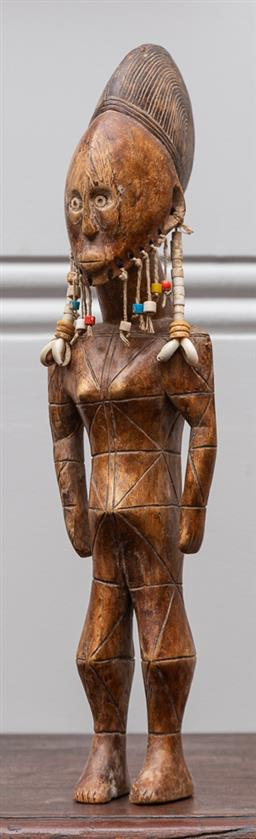 Sale 9160H - Lot 74 - African carved figure with geometric incisions to body, with beads and shells plaited beard, and shell eyes, Height 49cm