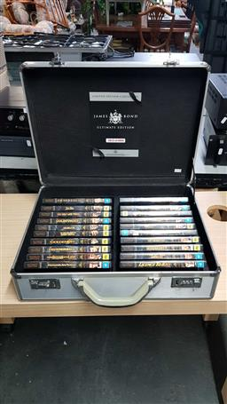 Sale 9176 - Lot 2334 - 007 themed case with DVDs inside