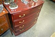 Sale 8093 - Lot 1412 - Bow Front Chest of 4 Drawers
