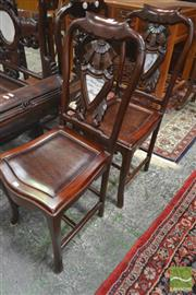 Sale 8255 - Lot 1011 - Set of Four Chinese Rosewood Chairs, the backs with Art Deco stylised flowers & small shield shaped marble panels