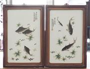 Sale 8319 - Lot 323 - Pair of Chinese rectangular porcelain blocks featuring various fish, signed and wood frames