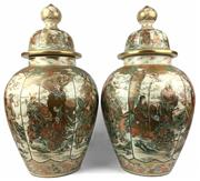 Sale 8995H - Lot 62 - A pair of large Satsuma lidded urns decorated in gilt with war scenes, restoration to one vase, height 55cm