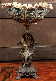 Sale 8942H - Lot 90 - A continental art nouveau style centre piece with spelter female figure upholding a ceramic thistle design bowl (damage to ceramic)
